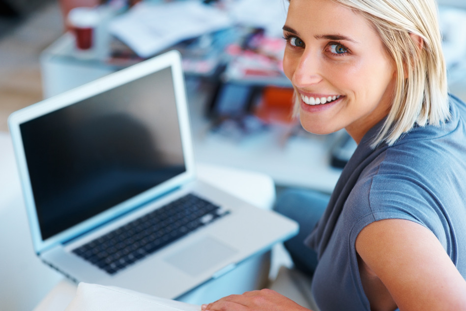 happy-woman-working-on-laptop
